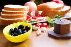 view of a wood table with olives tomatoes bread Royalty Free Stock Photography
