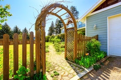 View of Wooden arbor. Arched entry to the garden. View of Wooden arbor and fence. Arched entry to the garden. Northwest, USA Royalty Free Stock Image