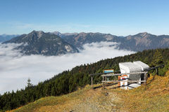 View of a wooden bench facing the beautiful panorama of Mountain Zugspitze from top of Mount Wank Stock Photography