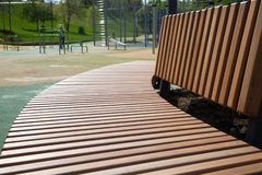 View of the wooden bench in the sports Park. royalty free stock photography