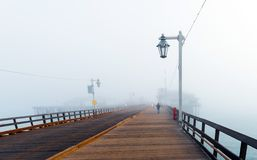 View of the wooden bridge in foggy weather, Santa Barbara, California, USA. Copy space for text royalty free stock photos