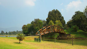 View of wooden bridge in the park Simon Bolivar in the city of Bogota Stock Photo