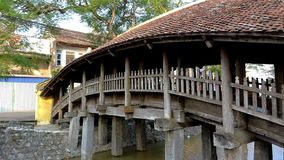 A view of a wooden bridge on a tile roof stock photos