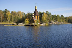 View of the wooden church of St. Andrew on the River Vuoksi sunny october day Royalty Free Stock Image