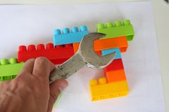 View on wooden cubes and colorful toy bricks. royalty free stock images