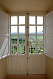 View through wooden doors to countryside Stock Photos