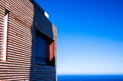 The view of a wood facade wit sky and sea stock photos