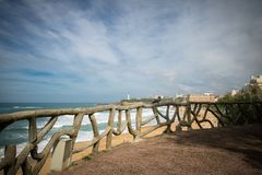 View through wooden fence on atlantic ocean in lovely Biarritz, Basque Country, France Stock Photography