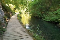 View of wooden footpath. View of wooden footpath and river Dove at Dovedale valley, Derbyshire, Peak district national park. England royalty free stock image