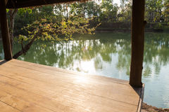 View from the wooden gazebo beside the lake Stock Images