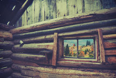 View from wooden house. Vintage colors. View from window of rustic wooden house to Carpathian mountain village. Ethnic cottage. Vintage colors Stock Image