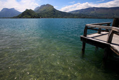 View from a wooden jetty over Lake Annecy Royalty Free Stock Photo