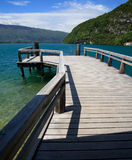 View from a wooden jetty over Lake Annecy Stock Images