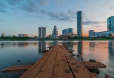 View of the wooden pier on the city pond and skyscrapers of Yekaterinburg stock photography