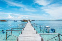 View of the wooden pier from the coast of Kanawa Island royalty free stock images