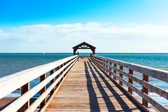 View of the wooden pier in Kauai, Hawaii islands. Copy space for text stock photography