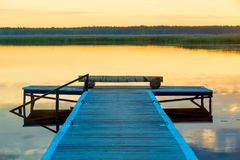 View of a wooden pier near a picturesque calm lake royalty free stock photo