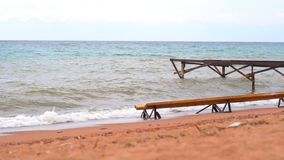 Pier on the sandy beach by the sea