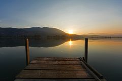 Wooden pier at the sunrise. View of a wooden pier at the sunrise. Kaiafas lake at western Peloponnese, Greece royalty free stock image