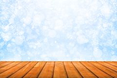 View on a wooden planks on a background of bstract winter snowfall stock photos