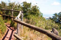 A view of the wooden railings on the observation deck of the monastery Escornalbou in Tarragona, Spain. With selective focus. A view of the wooden railings on Royalty Free Stock Photography
