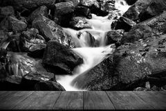 View from wooden table on stormy mountain river in a beautiful a Stock Photography