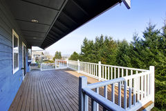 View of wooden walkout deck with white railings. Royalty Free Stock Photos