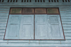View of wooden window on vintage wall of old wooden house at countryside. Stock Photography