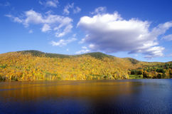 View of Woodstock, VT on lake in autumn Stock Photos