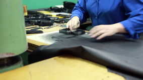 View of worker carves leather details for shoes stock video footage