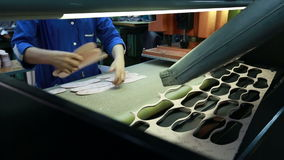 View of worker takes manufactured insoles stock video footage