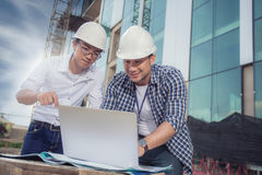View of workers and architects who see details about constructio Stock Photography