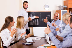 View at working meeting with diagram at background Royalty Free Stock Images