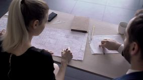 View of working table for which engineers with drawings work. stock video footage