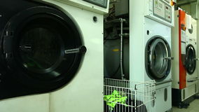 View of working washing machine in laundry Royalty Free Stock Photography