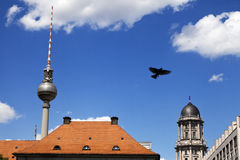 Berlin Buildings and Television Tower (Fernsehturm). View at the world famous Berlin television tower rising behind buildings Royalty Free Stock Images