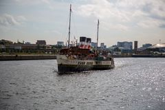 World famous Paddle Steamer Waverley heading down the River Clyde looking East from Govan, Glasgow, Scotland. A view of the world famous Paddle Steamer Waverley Royalty Free Stock Photos