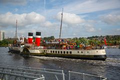 The Paddle Steamer Waverley heading down the River Clyde, Glasgow, Scotland. A view of the world famous Paddle Steamer Waverley heading down the River Clyde Stock Image