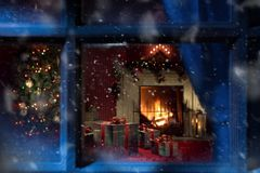 View of wrapped gifts and fireplace with christmas tree stock images