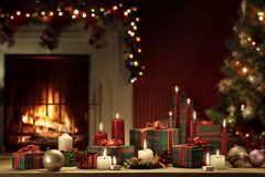 View of wrapped gifts and fireplace with christmas tree stock image