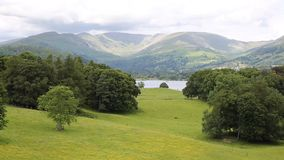 View from Wray Castle of Langdale Valley and mountains Lake District Cumbria uk. Country scene Langdale Valley and Fairfield Horse mountains from Wray Castle stock footage