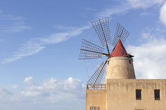 View of the wwf windmill in the salt pans. Trapani, Italy - December 29, 2014: View of the wwf windmill in the salt pans Royalty Free Stock Image