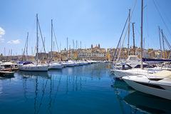 The view of yachts moored in harbor in Dockyard creek with Sengl Royalty Free Stock Photo