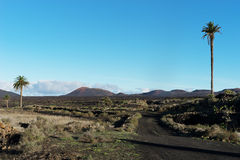 View from Yaiza towards Timanfaya. View from Yaiza towards National Park Timanfaya royalty free stock photo