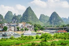 View of Yangshuo Town, amazing bridge and scenic karst mountains stock photography