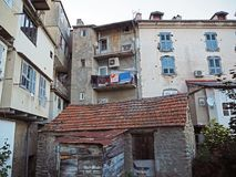 view on yard at old rental houses in corte city corsica with bal stock image
