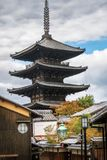 View of Yasaka Pagoda from a traditional street in Gion, Kyoto. Old traditional street with a Pagoda of a Shrine complex in the background in Gion District stock photo