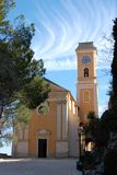 View on the yellow church of Eze, France Stock Photo