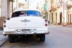 HAVANA, CUBA - APRIL 14, 2017: Closeup of yellow classic vintage car in Old Havana, Cuba. The most popular. View of yellow classic vintage car in Old Havana Stock Photo