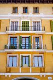 View of the yellow facade of the house in Mallorca. City center Royalty Free Stock Image